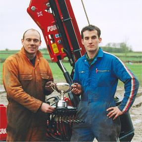 Steve Craddock and Andy Hooper next to machinery
